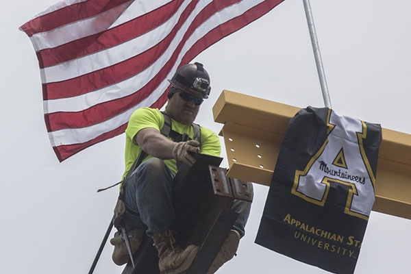 Workers celebrated in 'topping ceremony' for Appalachian's Beaver College of Health Sciences building